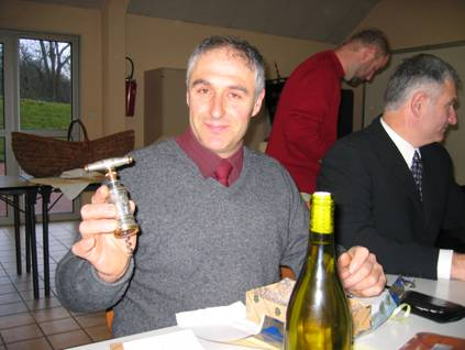 Guy Chaumont holding a corkscrew